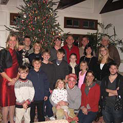 Family photo of the Tauck extended family in front of a Christmas tree