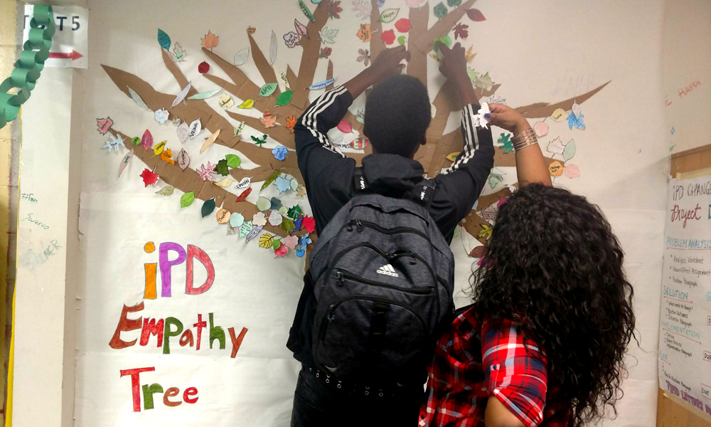 Teenagers putting finishing touches on Empathy Tree artwork