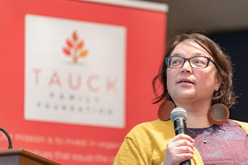 Woman speaking at the 2018 Tauck Family Foundation Cohort Gathering